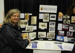 Leslie R looking at the United Church Archives Display at the Truth and Reconciliation Commission's National Event in Vancouver on September 21, 2013
