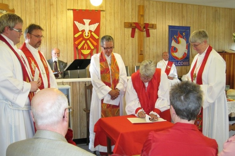 Signing Memorandum of Agreement for the Church of St Paul