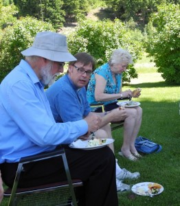 Glenn, Pastor Brian, and Laura-Ann chatting while enjoying lunch.