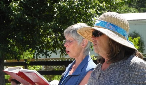 Joanne and Susan raising their voices in song.