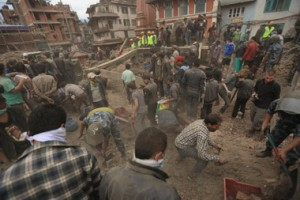 Nepalese scramble to assess the earthquake damage in Kathmandu and remove rubble in search of survivors. Photo credit: United Nations Development Programme.