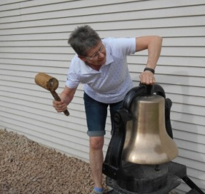 Leslie S testing the bell located in the Garden of the Redeemer in front of the Church of St Paul in preparation for the Make a Joyful Noise Event to Celebrate the 90th Anniversary of the United Church of Canada on June 10, 2015.  This bell had called the faithful to church in Clearwater until the congregation needed to leave their building.