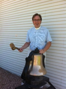 Pastor Brian taking his turn ringing the bell.
