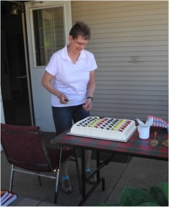 Leslie S getting ready to cut the cake for our celebration after we rang the bell 90 times.