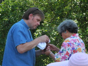 Pastor Brian serving Norma.