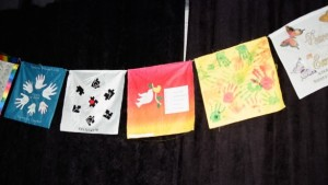 Clearwater United Church's Prayer Flag at GC40 hanging amidst others