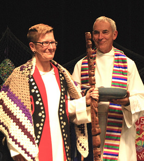 The Right Rev. Jordan Cantwell and the Very Rev. Gary Paterson as she receives symbols during her installation as the 42nd Moderator of the United Church of Canada. ~ source United Church of Canada's 42nd General Council webpage