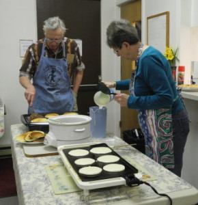 Mel and Leslie concentrating on preparing the pancakes.