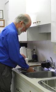 Glenn doing dishes