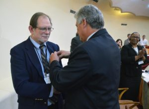 "Chris Ferguson, a United Church minister and General Secretary of the World Communion of Reformed Churches, being awarded the ""Medalla de la Amistad"" (Friendship Medal) from the Cuban government."