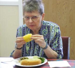 Leslie enjoying the corn.